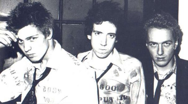 The Clash looking overjoyed at £25 quid a week! - (Don't Care colection)